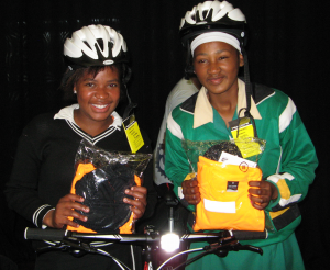 Children receiving their cycling kits at the project launch